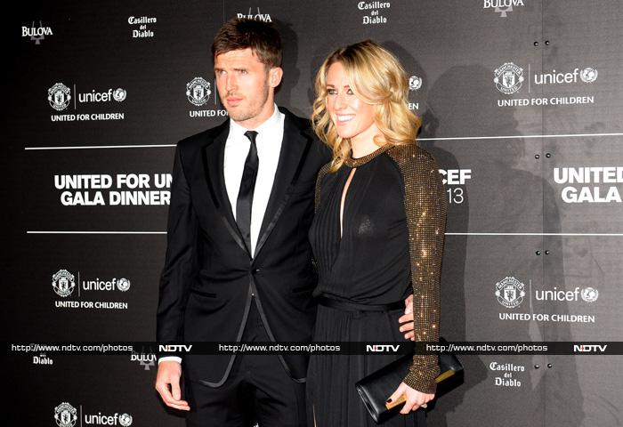 English midfielder Michael Carrick (L) and his wife Lisa.