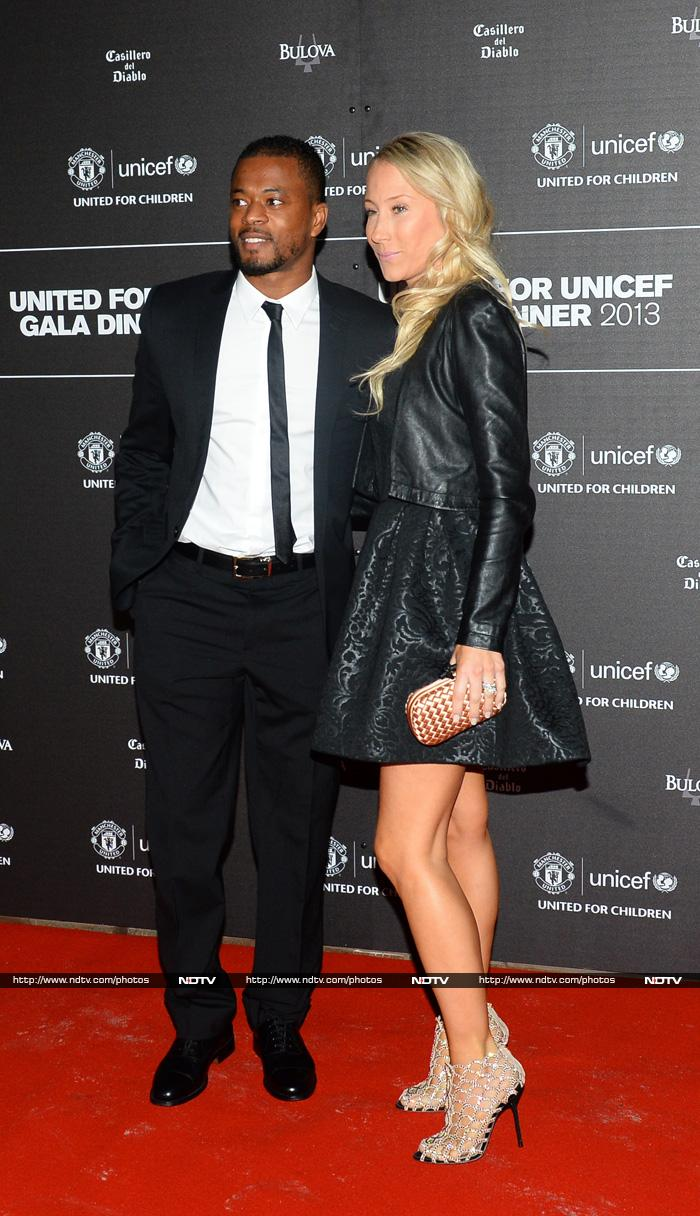 United's French defender Patrice Evra (L) ad his wife Sandra.