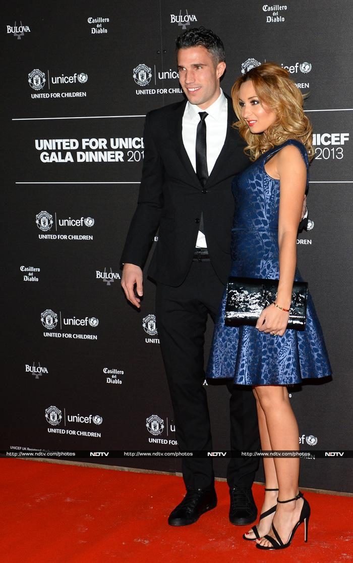 United's Dutch striker Robin van Persie (L) and his wife Bouchra pose for photographs as the arrive for a gala dinner in aid of UNICEF at Old Trafford.