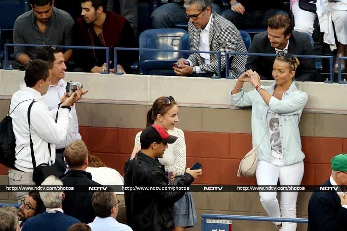 Beckham however did oblige eager fans by posing with them even while Nadal was taking a lead against Djokovic.<br><br>Click on for more celebrities who registered their attendance at the Arthur Ashe Stadium during the course of US Open 2013.