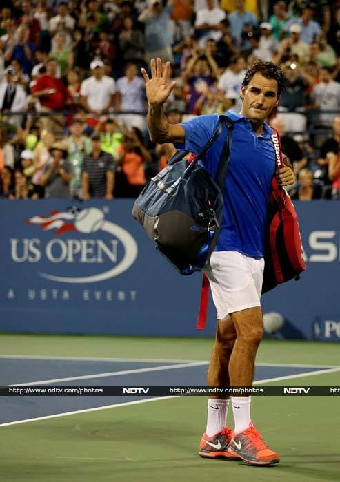 Federer lost in the fourth round of the U.S. Open for the first time in a decade, surprisingly beaten 7-6 (3), 6-3, 6-4 by 19th-seeded Tommy Robredo of Spain.