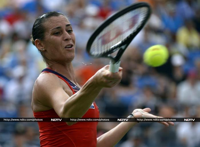 Unseeded Flavia Pennetta, now at 83 in the world, made then quarter-finals for a fourth time with a 6-2, 7-6 (7/3) win over Romanian 21st seed Simona Halep.<br><br>Now, life-long friends Roberta Vinci and Pennetta have set-up an all-Italian US Open quarter-final.