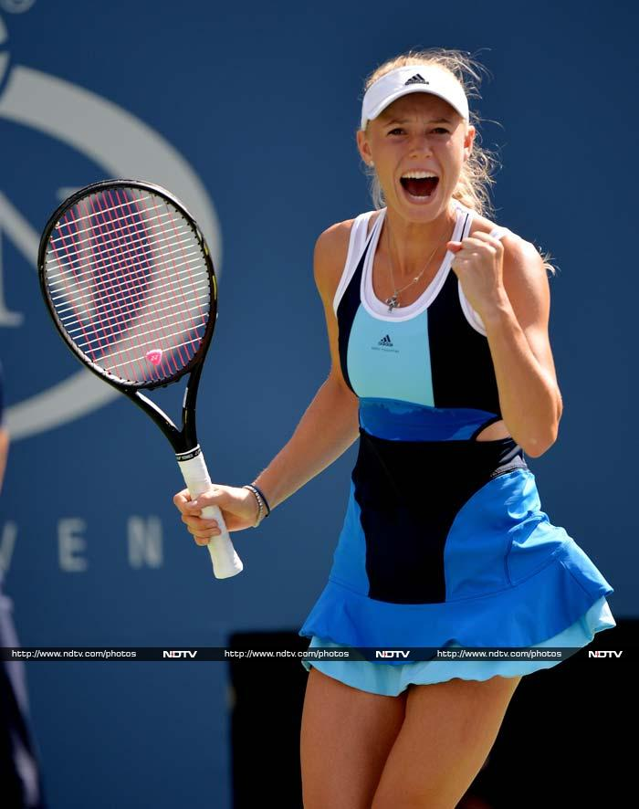 Denmark's Caroline Wozniacki too, much like Ivanovic, has eyes more on her fashion than her play.<br><br>Although knocked out of US Open, the former world number 1 opted for a mix-n-match dress which sported dark and light blue apart from that wierd 'superman-like' black V shaped design in the middle.
