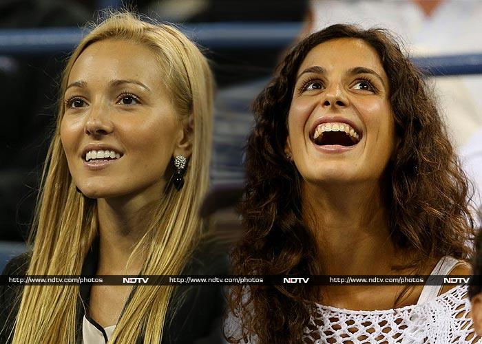 While their partners battle each other out on the US Open court for the title, both Jelena Ristic and Xisca Perello are expected to be a in a cheering battle of sorts to take their respective partners to glory. <br><br>Image courtesy AFP and AP.