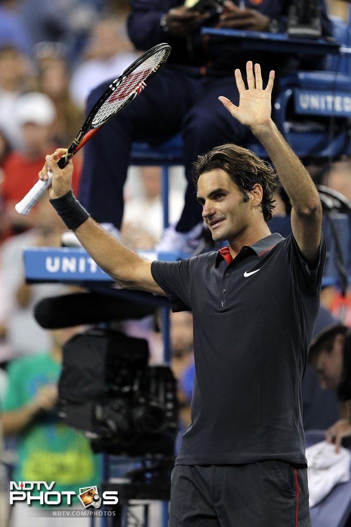 <b>Grateful:</b> Federer acknowledges the cheer after a match. Humility is also what has defined this player for long.