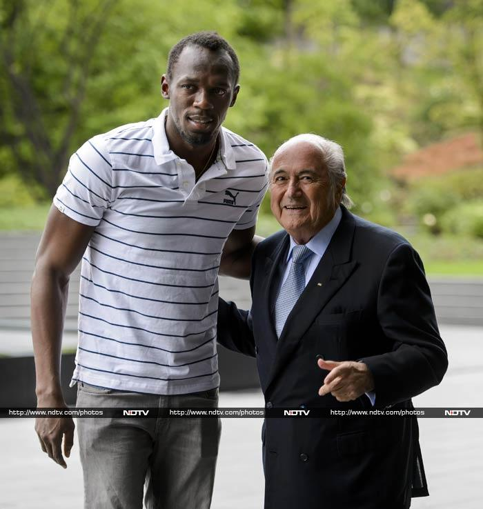 Bolt was in Zurich on Wednesday (August 28) and said it was a real honour to be at the FIFA headquarters.<br><br> He is seen here with FIFA president Sepp Blatter. <br><br>Image courtesy: AFP