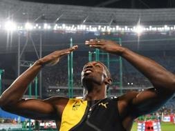 Photo : Usain Bolt Clinches Hat-Trick Of 100m Golds