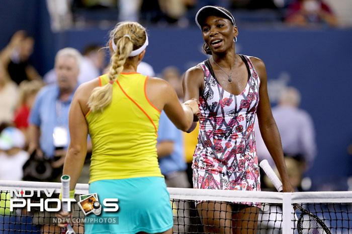 Venus Williams of the United States shakes hands at the net with Angelique Kerber of Germany after their women's second round match. The bigger of the Williams sisters was knocked out in the second round by the German. (All AFP Photos)