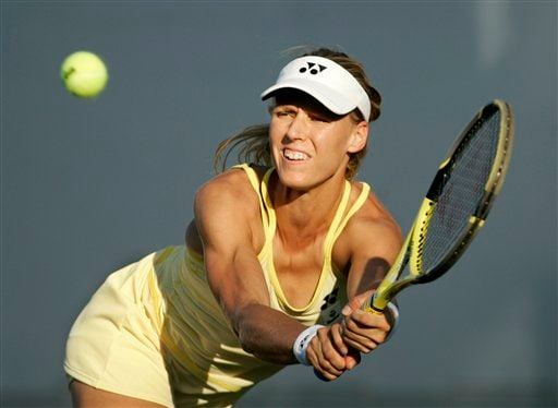 Elena Dementieva of Russia returns a shot to Stephanie Cohen-Aloro of France during the first round of the US Open tennis tournament in New York, Monday, Aug. 27, 2007.
