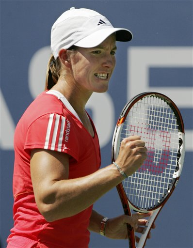Justine Henin of Belgium reacts after winning a point against Julia Goerges of Germany during the first round of the US Open tennis tournament in New York, Monday, Aug. 27, 2007.