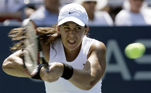 Marion Bartoli of France returns a shot to Alexa Glatch of the United States during the first round of the US Open tennis tournament in New York, Monday, Aug. 27, 2007.