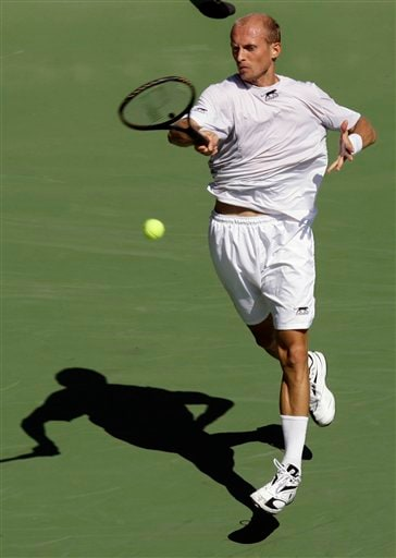Nikolay Davydenko of Russia returns a shot to Jesse Levine of the United States during the first round of the US Open tennis tournament in New York, Monday, Aug. 27, 2007.