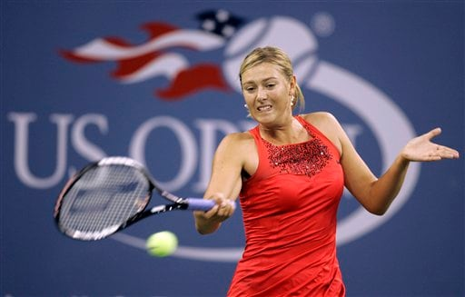 Maria Sharapova of Russia returns a shot to Roberta Vinci of Italy at the US Open tennis tournament in New York, Tuesday, Aug. 28, 2007.