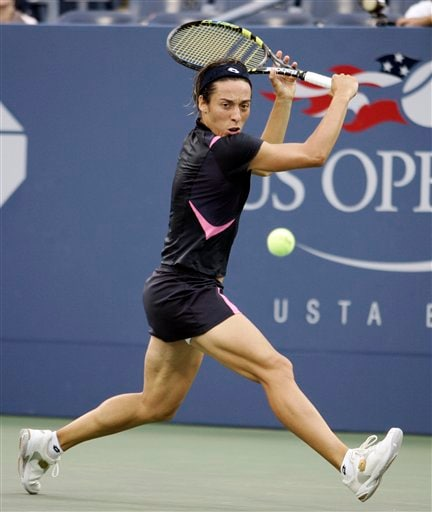 Francesca Schiavone of Italy returns a shot to Nathalie Dechy of France at the US Open tennis tournament in New York, Tuesday, Aug. 28, 2007.