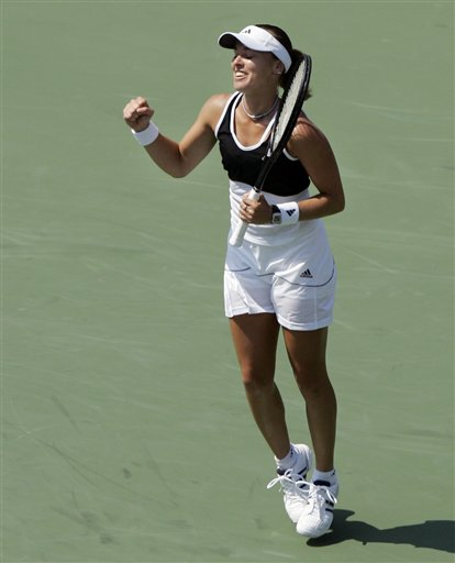 Martina Hingis of Switzerland reacts after defeating Mathilde Johansson of France at the US Open tennis tournament in New York, Tuesday, Aug. 28, 2007.