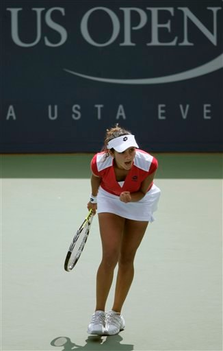 Sania Mirza of India pumps her after defeating Kaia Kanepi of Estonia at the US Open tennis tournament in New York, Tuesday, Aug. 28, 2007.