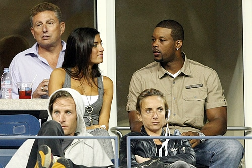 Kerry Rhodes (R) #25 of the New York Jets watches Roger Federer of Switzerland play Robin Soderling of Sweden during day ten of the 2009 U.S. Open at the USTA Billie Jean King National Tennis Center on Wednesday in the Flushing neighborhood of the Queens borough of New York City. (AFP Photo)