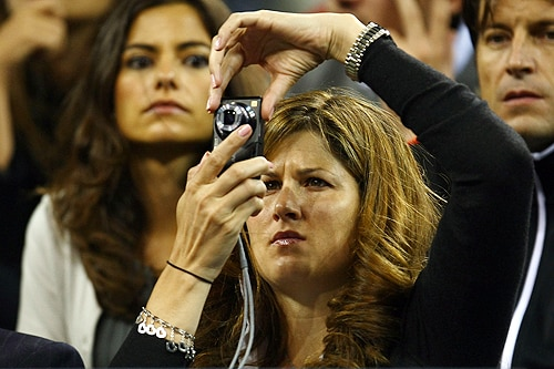 Mirka Federer, wife of Roger Federer of Switzerland, takes a photo during his match against Robin Soderling of Sweden during day ten of the 2009 U.S. Open at the USTA Billie Jean King National Tennis Center on Wednesday in the Flushing neighborhood of the Queens borough of New York City. (AFP Photo)