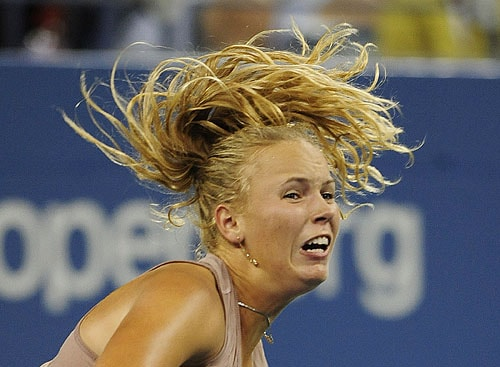 Denmark's Caroline Wozniacki returns a point against Russia's Svetlana Kuznetsova, during day eight of the 2009 US Open at the USTA Billie Jean King National Tennis Center on Monday in the Flushing neighborhood of the Queens borough of New York City. (AFP Photo)