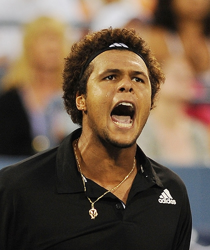 Jo-Wilfried Tsonga of France celebrates winning a game against Fernando Gonzalez of Chile during their quarterfinal round US Open match at the USTA Billie Jean King National Tennis Center on Tuesday in New York. (AFP Photo)