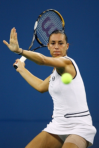 Flavia Pennetta of Italy returns a shot against Serena Williams during day nine of the 2009 US Open at the USTA Billie Jean King National Tennis Center on Tuesday in the Flushing neighborhood of the Queens borough of New York City. (AFP Photo)