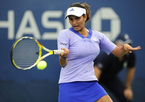 Sania Mirza returns a shot to Belarus Olga Govortsova during the first round of the US Open at the USTA Billie Jean King National Tennis Center in New York on August 31. (AFP Photo)