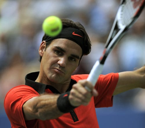 Roger Federer of Switzerland hits the ball against Devin Britton of the US during their 1st round US Open match at the USTA Billie Jean King National Tennis Center in New York on August 31. (AFP Photo)
