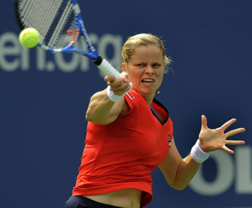 Kim Clijsters hits against Viktoriya Kutuzova of the Ukraine during her 1st round US Open match at the USTA Billie Jean King National Tennis Center in New York on August 31. (AFP Photo)