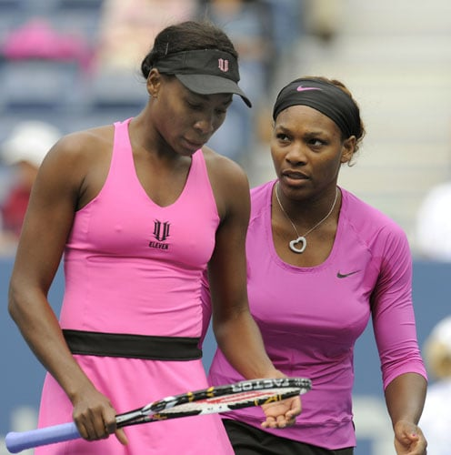 Serena and Venus Williams of the US play against Alisa Kleybanova and Ekaterina Makarova of Russia during their women's doubles semi-finals US Open match in New York. (AFP Photo)
