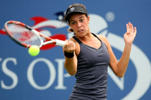 Beatrice Capra returns a shot to Asia Muhammad during the girls' singles third round match on day eleven of the 2009 US Open in New York. (AFP Photo)