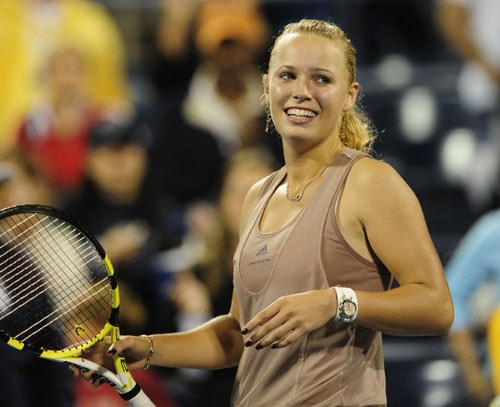 Danish tennis player Caroline Wozniacki celebrates after winning against Belgium player Yanina Wickmayer in their semi-final match of the 2009 US Open at the USTA Billie Jean King National Tennis Center in New York on September 12, 2009. (AFP Photo)