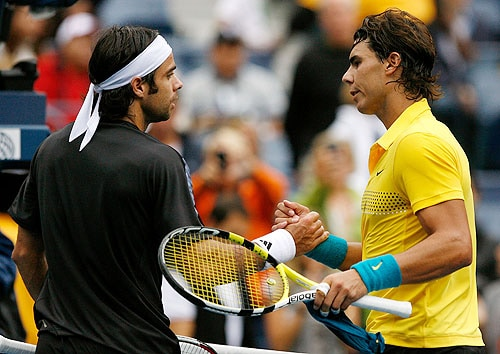 Rafael Nadal of Spain (R) greets Fernando Gonzalez of Chile at the net after the men's singles quarter-finals match on day thirteen of the 2009 US Open in New York. (AFP Photo)