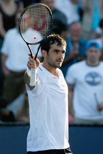 Florent Serra of France celebrates after his defeat against Janko Tipsarevic of Serbia during day two of the 2009 US Open at the USTA Billie Jean King National Tennis Center on September 1, 2009. (AFP Photo)
