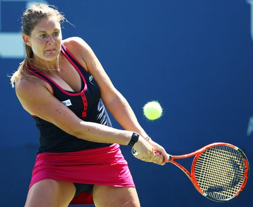 Julie Coin of France returns a shot against Nadia Petrova of Russia during day four of the 2009 US Open at the USTA Billie Jean King National Tennis Center on September 3, 2009. (AFP Photo)
