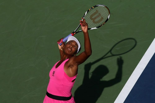 Venus Williams serves during her doubles match with Serena Williams against Julia Goerges of Germany and Arantxa Parra Santonja of Spain during day four of the 2009 US Open at the USTA Billie Jean King National Tennis Center on September 3. (AFP Photo)