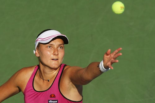 Nadia Petrova of Russia serves against Jie Zheng of China during day six of the 2009 US Open at the USTA Billie Jean King National Tennis Center in the Flushing neighborhood of the Queens borough of New York City. (AFP Photo)