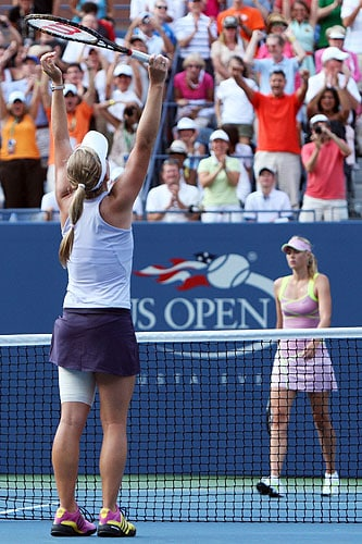 Melanie Oudin (L) of the United States celebrates match point against Maria Sharapova of Russia during day six of the 2009 US Open at the USTA Billie Jean King National Tennis Center in the Flushing neighborhood of the Queens borough of New York City. (AFP Photo)
