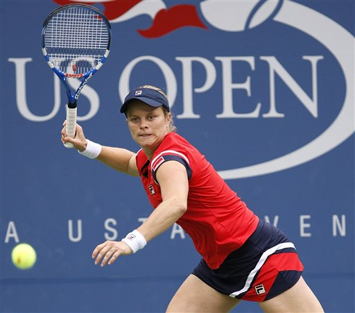 Kim Clijsters, of Belgium, returns to Venus Williams, of the United States, in the fourth round of the US Open in New York. Clijsters won 6-0, 0-6, 6-4. (AP Photo)