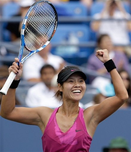 Li Na of China celebrates her 6-2, 6-3 victory over Francesca Schiavone of Italy during the fourth round of the US Open in New York. (AP Photo)