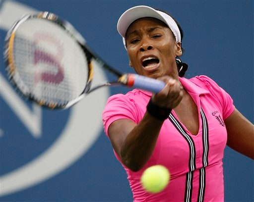 Venus Williams, of the United States, returns to Kim Clijsters, of Belgium, in the fourth round of the US Open in New York. (AP Photo)