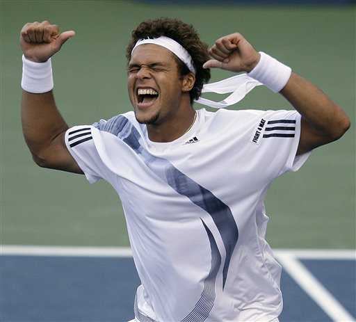Jo-Wilfried Tsonga of France, celebrates his 7-6 (4), 6-2, 6-4 victory over countryman Julien Benneteau during the third round of the US Open in New York. (AP Photo)