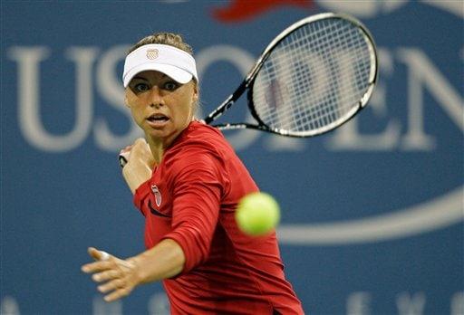Vera Zvonareva of Russia, returns a shot to Flavia Pennetta of Italy, during the fourth round of the US Open in New York. (AP Photo)