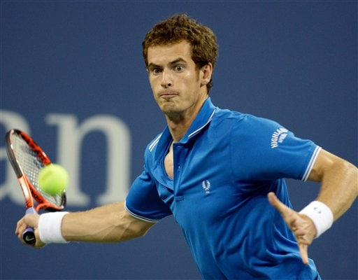 Andy Murray of Britain, returns a shot to Taylor Dent of the United States, during the third round of the US Open in New York. (AP Photo)