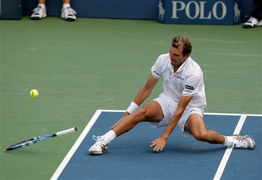 Julien Benneteau of France, skids on the court as he cannot reach a return to Jo-Wilfried Tsonga of France, in the third round of the US Open in New York. (AP Photo)