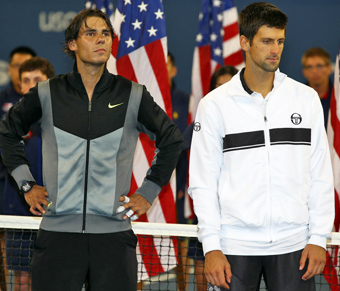 Rafael Nadal of Spain and runner up Novak Djokovic of Serbia look on during the trophy ceremony after their men's singles final on day fifteen of the 2010 US Open at the USTA Billie Jean King National Tennis Center. (AFP Photo)