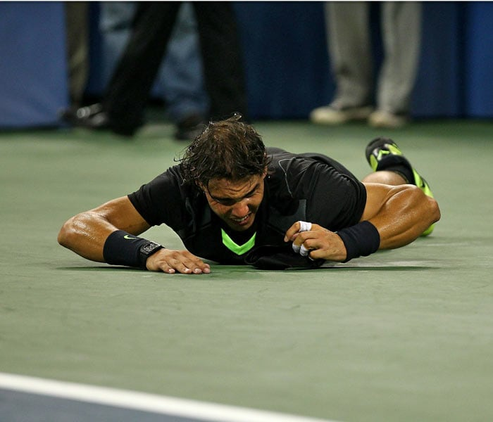 Rafael Nadal of Spain rolls on the ground in celebration of his win over Novak Djokovic of Serbia during their men's singles final on day fifteen of the 2010 US Open at the USTA Billie Jean King National Tennis Center. (AFP Photo)