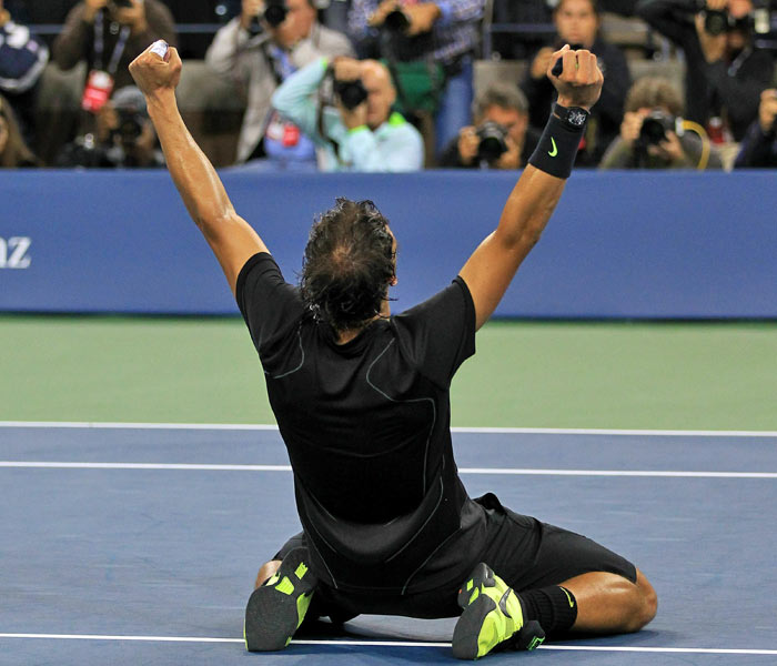 Rafael Nadal of Spain falls to his knees in celebration of his win over Novak Djokovic of Serbia during their men's singles final on day fifteen of the 2010 US Open at the USTA Billie Jean King National Tennis Center. (AFP Photo)