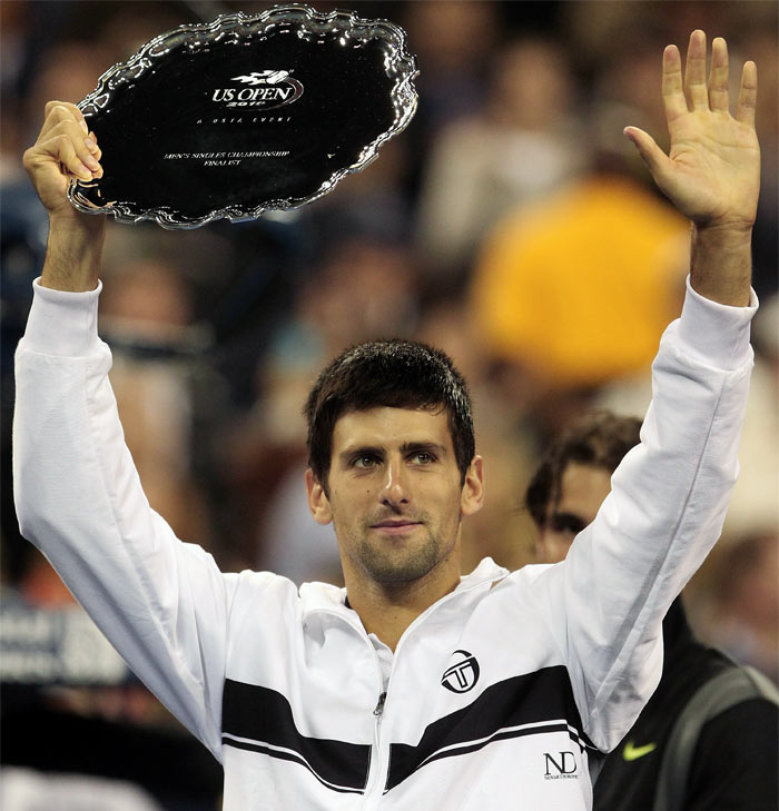Runner up Novak Djokovic of Serbia celebrates with his trophy after being defeated by Rafael Nadal of Spain during their men's singles final on day fifteen of the 2010 US Open at the USTA Billie Jean King National Tennis Center. (AFP Photo)