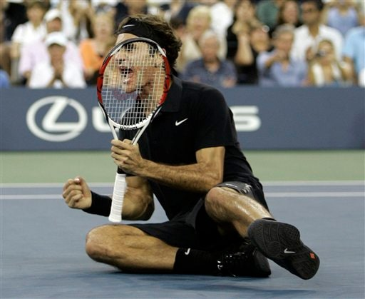 Roger Federer of Switzerland celebrates after winning the men's finals against Novak Djokovic of Serbia at the US Open tennis tournament in New York, Sunday, Sept. 9, 2007