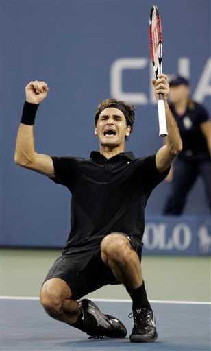 Roger Federer of Switzerland celebrates after winning the men's finals against Novak Djokovic of Serbia at the US Open tennis tournament in New York, Sunday, Sept. 9, 2007.